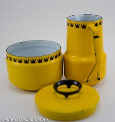 Vintage Danish Dan Kok Glud and Marstrand Mid-Century Modern Yellow Enamel Sugar Bowl and Creamer.  Just imagine this stunning enameled yellow cream and sugar set on your dining table. Mid-modern Danish design at its finest with repeating black patterning at the top to match the black rim of the enameling. Such a rare and wonderful find! This set is in excellent vintage condition and is sure to appeal to those collectors of quality Mid-modern pieces.  Rare and hard to find   Measurements…