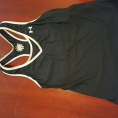 Under Armour Racerback Tank Top Under Armour racerback tank top in medium sized. It has a built in bra and a zipper on the right side for storing cash or something small while exercising. Is in very good conditiom except the tag on the inside back of the top is fading. It is made of a cooling material that wicks away moisture. Fits more like a small. Under Armour Tops Tank Tops