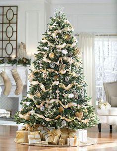 A beautiful Christmas tree. White Christmas Trees, Silver Christmas Decorations, Ribbon On Christmas Tree, Beautiful Christmas Trees, Magical Christmas, Christmas Tree Toppers, Pink Christmas, Outdoor Christmas, Xmas Tree