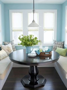 Small, narrow dining space-round table, built-in banquette seating
