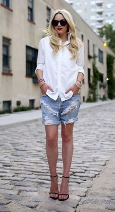 Dress up ripped cutoffs with a white button-up and 17 other blogger ideas