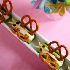 Butterfly-Themed Snack:  Body – Celery with frosting or peanut butter spread on it  Wings – 2 Pretzels  Eyes – 2 Mini chocolate chips  Antennae – Slivered almonds