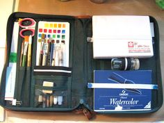 This is just an update on my watercolortravel kit from the post below.I added some elastic straps to hold things in a little better...