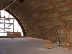 A curved straw bale wall, non load bearing.  Inspirational.