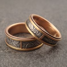 The main difference between this and my other sunflower patterned rose gold bands is that the side rails on these rings are also rose gold.  I think this brings out the contrast with the sterling silver in the center all the more powerfully.