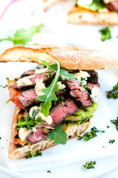 Grilled Balsamic Steak Sandwiches - The ultimate summer sandwich recipe with balsamic marinated steak, fresh heirloom tomatoes, arugula, and homemade gremolata between a delicious grilled baguette. Grill Sandwich, Croissant Sandwich, Baguette Sandwich, Steak Sandwich Recipes, Steak Recipes, Grilling Recipes, Cooking Recipes, Chicken Recipes, Spinach Recipes