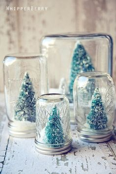 If you set up miniature Christmas towns with Christmas, you probably have some little trees left and there's always a little fake snow left. Glue the tree to the lid of a jar, sprinkle some fake snow and put the jar on top. Gives an adorable effect with old fashioned jars!