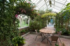 Our wonderful conservatory, bursting with plants and colours. Many bridal parties like to use this as their wedding aisle when getting married outside!