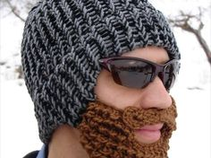 "And you ask yourself right now ""Why did I not think about this?"" Yes, we also do. This is a fantastic idea that will keep you warm on a cold trick or treating night. > ... black and gray tweed knitted stocking cap with shaggy brown beard and mustache attached. The hat is knitted on a round loom and the brown beard and mustache are hand crocheted."