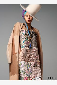 """Erykah Badu, 43, Singer-songwriter """"I was raised a child of the funk era: Betty Davis and Bootsy Collins. I've always enjoyed a very loosely put together style that feels like maybe I slept in it the night before—almost hobo chic. Effortless."""" Cashmere coat, silk and chiffon dress, both, Maison Martin Margiela. Her own hat, head wrap, and necklaces."""