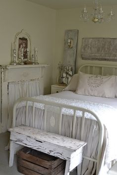white bedroom-fireplace, bench, sconce