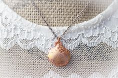 A personal favorite from my Etsy shop https://www.etsy.com/listing/255023499/shell-pendant-copper-sea-shell-bohemian