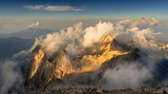 View from Mt. Triglav 2864 m asl, Triglav National Park, Slovenia. I took this shot in a last rays of setting sun hitting just the tops of the mountains below. I was the last one who climb down from the top but I think the result was worth the effort.