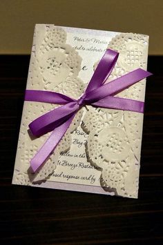 absolutely lace these wedding invites , vintage style lace doilies with purple & lilac