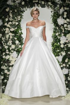 Berkeley - Anne Barge, Fall 2016 Collection - Bridal gown with a ball gown skirt, pockets, draped bodice, and off the shoulder neckline.