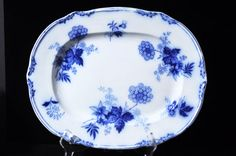165 yrs. old Beautiful Flow Blue Platter by SouthernSisAntiques