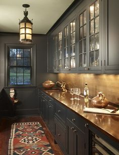 Gray cabinets with copper counter top.