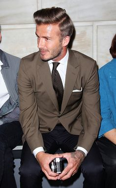 David Beckham, brown jacket, polka dot tie, white shirt, navy wool trousers.