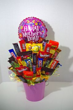 A handmade arrangement of your favorite candy in a pink tin with a colorful bow and Mother's Day Balloon. Arrangement contains a mix of candy including Kit Kat, Skittles, Twix, Variety of M&Ms, Almond Candy Boquets, Candy Bouquet Diy, Diy Bouquet, Gift Card Bouquet, Mothers Day Baskets, Mothers Day Crafts, Mother Day Gifts, Candy Gift Baskets, Mother's Day Gift Baskets