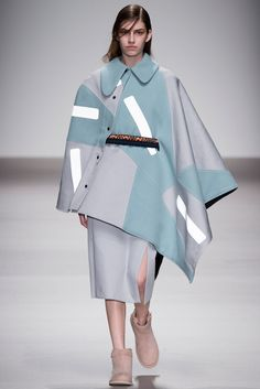 Christopher Raeburn F/W 2015, at LFW. Super interesting slanted poncho opening, especially with the droopy Peter Pan collar.