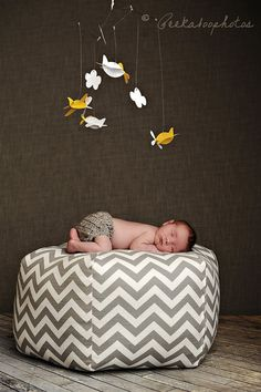 OK, this person is a marketing genius. The listing is for the Ottoman Pouf, which I love, but adding the baby and the bird mobile? Totally inspired. (aletafae, $100.00)