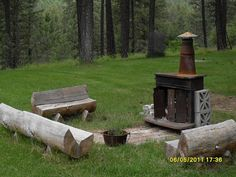 our outdoor woodstove in the summer - Stuey says we can do it with our old fireplace!