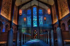 Inside the chapel with beautiful light coming through the stained glass windows