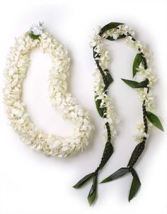 A pair of wedding leis made especially for the bride and groom with beautiful white orchids.