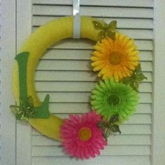 I made a yarn wrapped wreath for my front door for Spring/Summer!! The yarn is actually yellow if you can't tell from the dark picture!