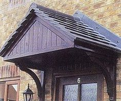 """Canopy with closed gable from UK. (Better for keeping rain off the door?) Manufactured with projection of 730 mm, (2'4.74""""), or 880 mm (2'10.6""""). Also love the arched brackets."""