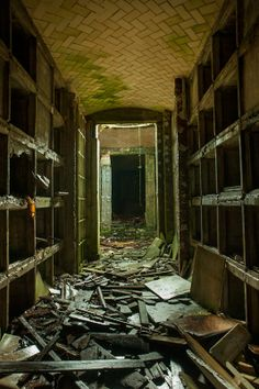 Hallway of abandoned mausoleum that has been heavily vandalized; Hamilton Mausoleum
