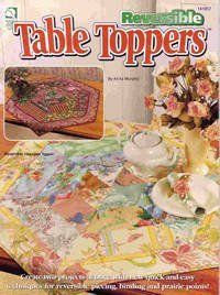 {Table Toppers} Reversible Table Toppers: Create Two Projects at Once With New Quick-and-Easy Techniques for Reversible Piecing, Binding and Prairie Points! (141057) by Anita {Designs By} Murphy, http://www.amazon.com/dp/B000J46588/ref=cm_sw_r_pi_dp_FwgDrb1D8VK59