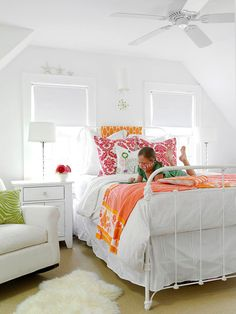 iron bed, white bedding and pops of color for R's room