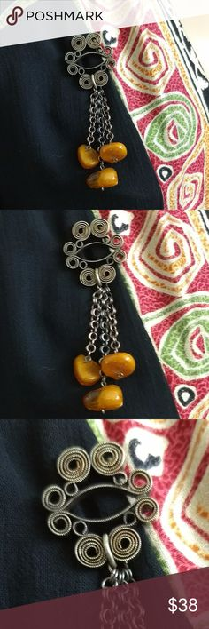 "Antique Natural Baltic Amber Silver Dangle Brooch Exceptional Victorian Art Nouveau silver tone Natural Baltic Amber Dangle Drop brooch.  Handmade silver tone metal is set in tight swirls to form the 1 1/4"" pin section.  Three chains and Baltic Amber stones dangle from a center link.  Natural Amber stones are about 3/4"" across. Longest dangle drop is 2 1/2"". Total length ~ 3 3/4"".  Secure C-clasp is soldered to the back.  Possibly one-of-a-kind!  EUC - Buyer may wish to clean to their…"