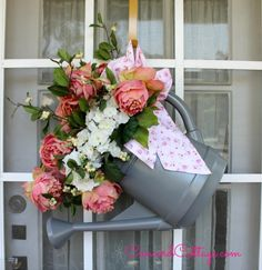 Watering Can Door Hanger you can make by spray painting an old shabby watering can n add flowers