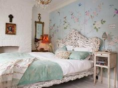 This mural is gorgeous! I'd have a different bed frame though... It is all a bit too feminine together. Oooo, maybe a reclaimed wood headboard misshaped? Hmmm