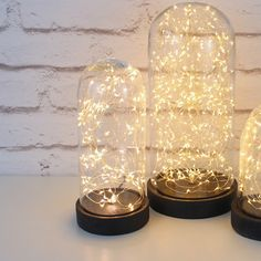 The Galaxy Domes by Headsprung are a range of decorative table lights consisting of rustic glass domes housing modern, energy-efficient LED string lights. ideal for the wedding table Glass Vessel, Glass Domes, Mosaic Glass, Light Table, Lamp Light, Starry String Lights, Metal Baskets, Laque, Industrial Style