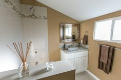 Bathroom that has beige walls, marbled grey/white sink with mirror. Classy! #HomeDecor #RealEstate #HouseFlipping #Tujunga #California  www.verono.com/nassau