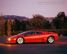 LAM 01 RK0063 02 - Lamborghini Diablo Red Profile View On Pavement At Night By Trees - Kimballstock
