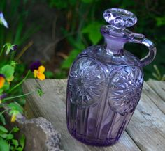 Amethyst Decanter with Stopper Vintage Antique Cut Glass or Crystal Purple Amethyst 8.5 Tall... Chips on portion of the stopper that seats inside the bottle....see photo. Beautiful piece.