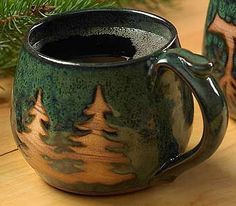 I am a sucker for a good tree desgin. | stoneware coffee mug from Wildwings