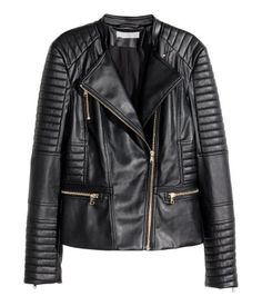 Biker jacket in imitation leather with quilted sections. Diagonal zip at front, side pockets with zips, and zips at cuffs. Lined.