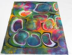Marbling over the ice dyed fabric with wood fabric stamping