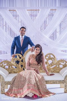 Indian couple posing at the reception stage. http://www.maharaniweddings.com/gallery/photo/95940