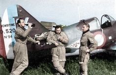 French D.520 fighter plane with its pilots somewhere in the early 40's.