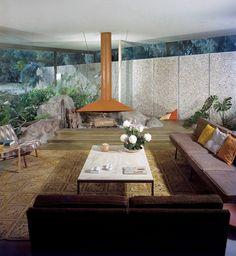 Photo of the living room of the Williams (Stewart) House with a nice open fireplace. Located in Palm Springs, California it was designed by Williams, Williams, and Williams in Photo: Getty / Shulman Mid Century Decor, Mid Century House, Mid Century Furniture, Minimalist Home Decor, Minimalist Bedroom, Minimalist Interior, Minimalist Living, Minimalist Kitchen, Modern Minimalist