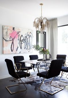 The set of Milo Baughman chairs is one of many standouts in the dining room, along with the graffiti-inspired Elisa Gomez painting and a smoked glass chandelier found on Craigslist.