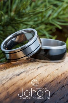 Exotic African blackwood and black enamel decorate these handmade titanium wedding bands from Jewelry by Johan. #JewelrybyJohan