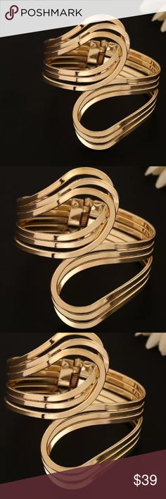 Gold tone cuff bracelet Gold tone cuff bracelet. Super Chic! New in package Jewelry Bracelets