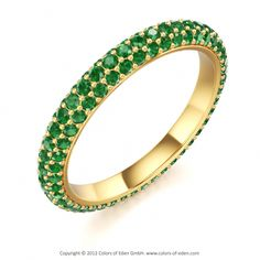 Go Green in this lovely Andromeda Galaxy Band in round Emeralds + 18k Yellow Gold. Like all creations of our collection Eden Edition, this design is characterized by classical elegance, timelessness and sense of style.